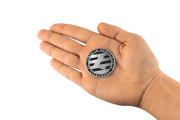 Argent litecoin à portée de main, pièce de monnaie crypto-monnaie isoler sur fond blanc photo