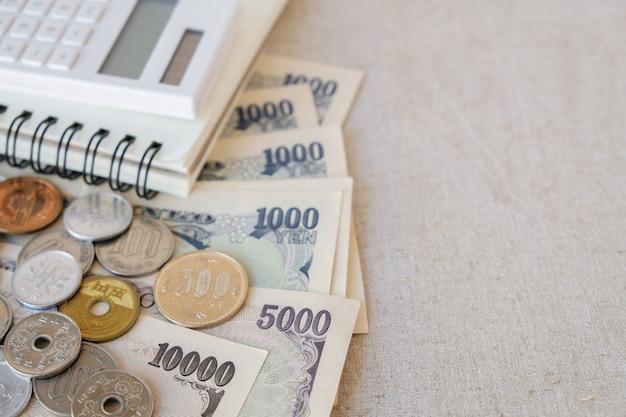 Argent de yen japonais, avec calculatrice, cahier, espace de copie