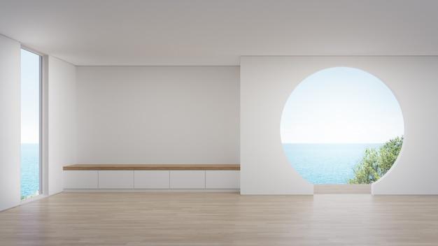 Armoire sur plancher en bois du grand salon vide.