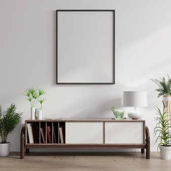 Armoire avec plantes et affiche vierge sur mur blanc
