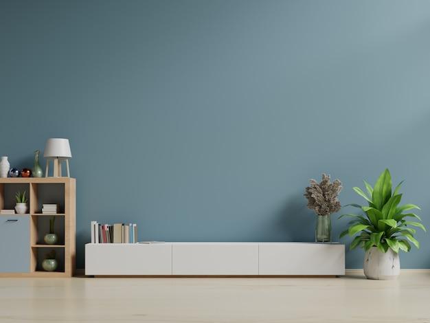Armoire tv dans une pièce intérieure vide, mur sombre avec étagère en bois, lampe, plantes et bois de table