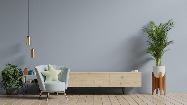 Armoire tv dans salon moderne, intérieur d'un salon lumineux avec fauteuil sur fond de mur gris vide.