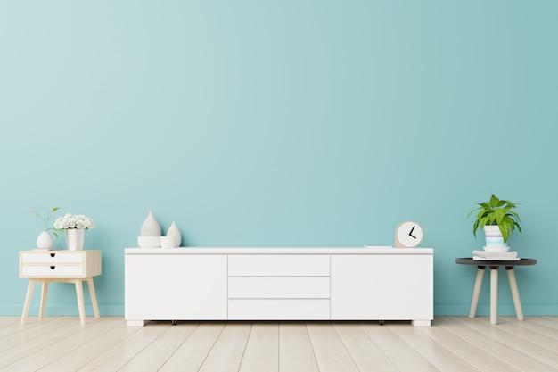 Armoires de télévision dans une chambre, murs bleus