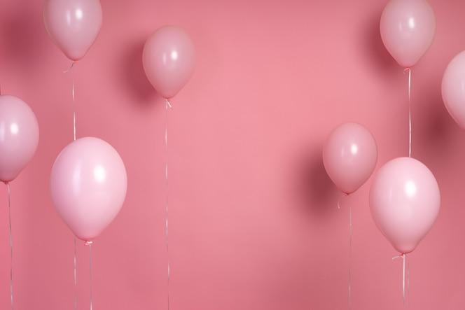 Arrangement de ballons roses avec espace copie
