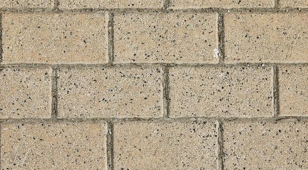 Arrière-plan du mur de pierre du château fait de pierres de différentes formes, tailles et textures.