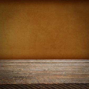 L'arrière-plan est constitué de planches de bois vierges et d'un mur en plâtre texturé avec éclairage et vignettage. pour les démonstrations de produits, l'espace libre, la mise en page, la maquette, le tableau de perspective, le tableau d'arrière-plan.