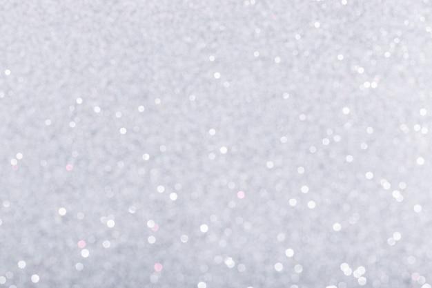 Arrière-plan flou d'étincelles brillantes argentées