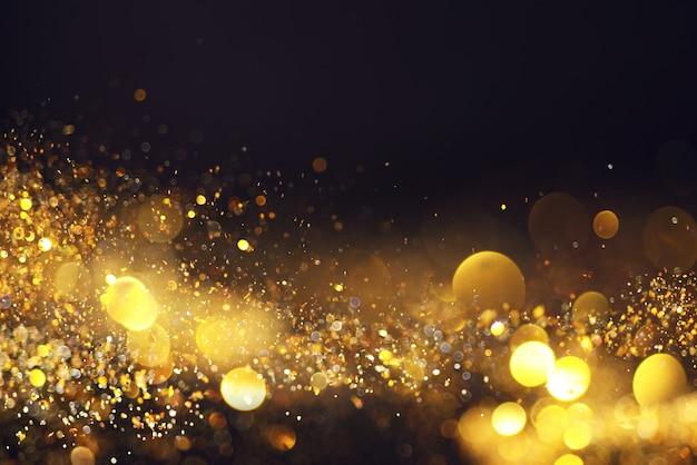 Arrière-plan flou avec des lumières jaunes sur fond noir
