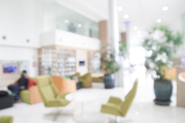 Arrière-plan flou de moderne showroom blanc ou clair ou un café