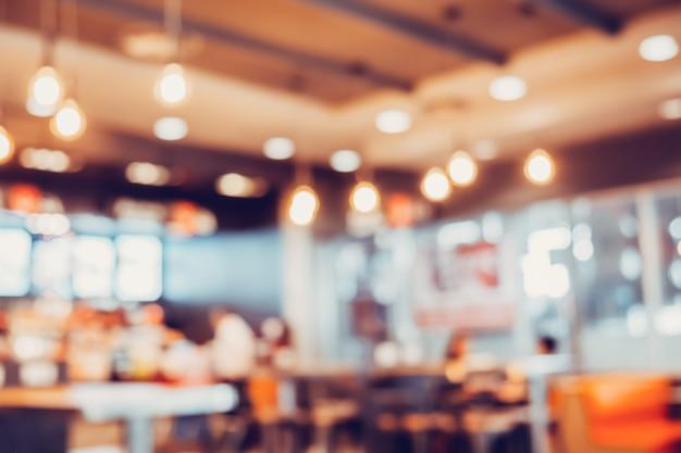 Arrière-plan flou des personnes assises au café en centre commercial.
