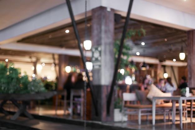 Arrière-plan flou de personnes qui visitent le concept de café du matin