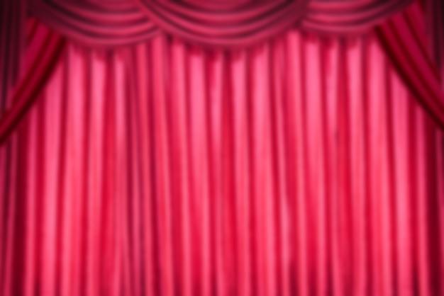 Arrière-plan flou de rideau rouge