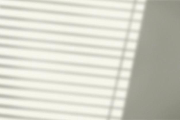 Arrière-plan avec l'ombre des stores pendant l'heure d'or