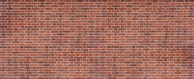 Arrière-plan panoramique de la large vieille texture de mur de briques rouges et brunes. toile de fond de conception de maison ou de bureau. mur de briques vintage