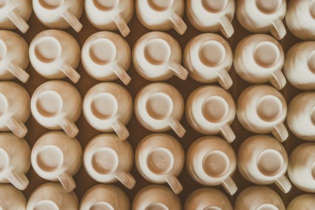 Arrière-plan avec des tasses à café commandés