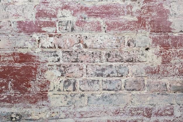 Arrière-plan de la texture du mur de briques anciennes et large