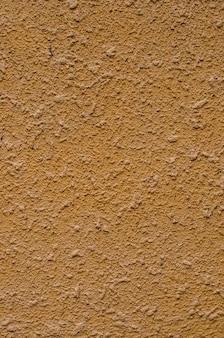Arrière-plan, texture d'une façade moderne en plâtre d'un immeuble résidentiel. revêtement mural extérieur plâtre beige.