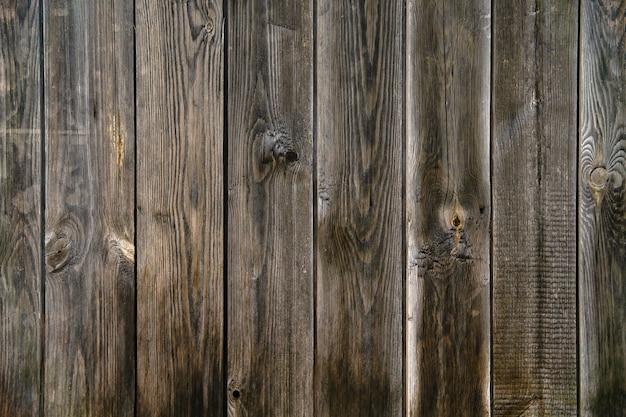Arrière-plan, texture - vieille clôture en planches de planches brutes non peintes