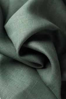 Arrière-plan avec un tissu en lin vert, image vue de haut en bas