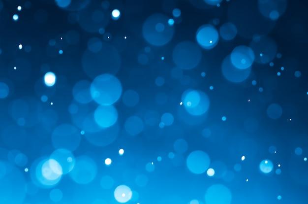 Arrière-plans abstraits bleu foncé avec bokeh.