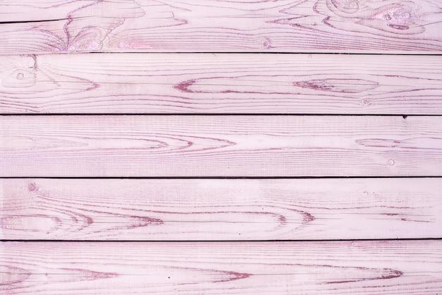 Arrière-plans de texture bois vieux rose. rayures horizontales, planches. rugosité et fissures.