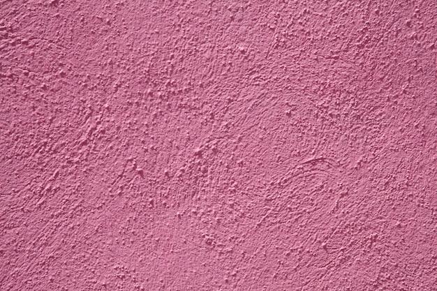 Arrière-plans et textures de ciment mur rose