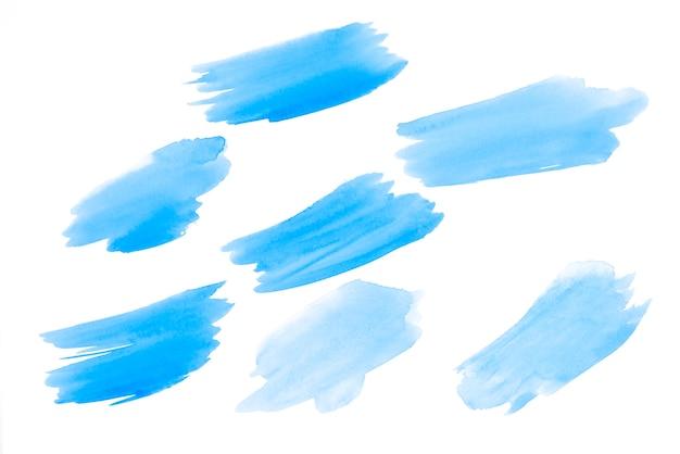 Arrière-plans uniques dessinés à la main aquarelle bleu ciel pour votre conception