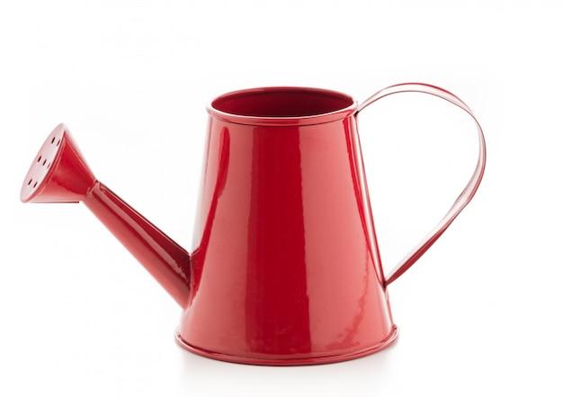 Arrosoir rouge peut isolé de l'eau