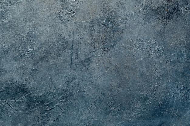 Art abstrait fond texturé bleu foncé.