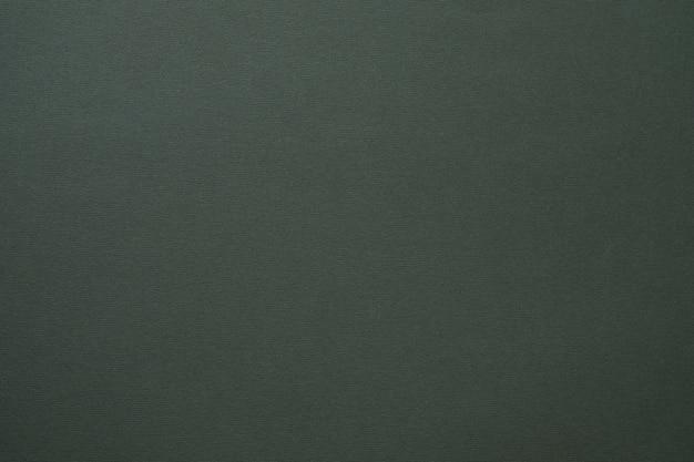Art abstrait de texture feutre gris foncé matériau de couleur unie avec surface de grain