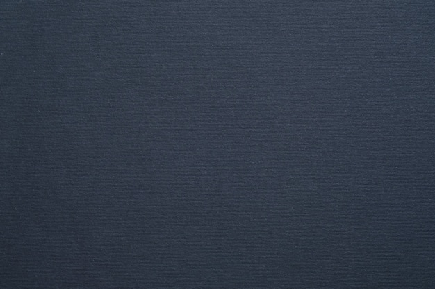 Art abstrait de texture de feutre gris foncé surface de carton colorée.