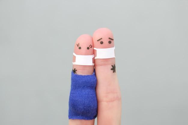 Art de doigt de couple dans des masques médicaux attendant bébé
