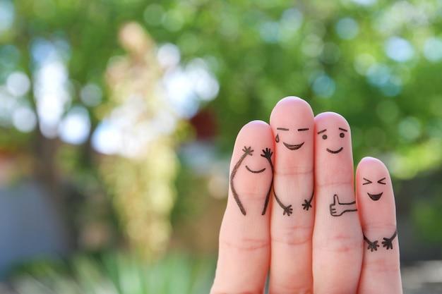 L'art des doigts de la famille. le concept de groupe de personnes qui rient.