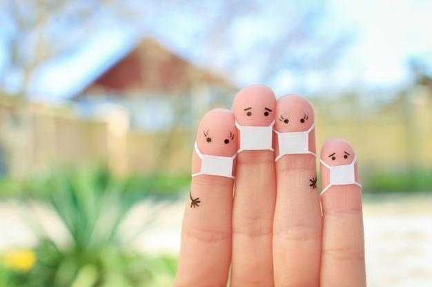 Art des doigts de famille avec masque facial.