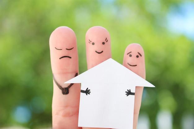 L'art des doigts de la famille pendant la querelle. le concept d'homme et de femme divise la maison après le divorce.