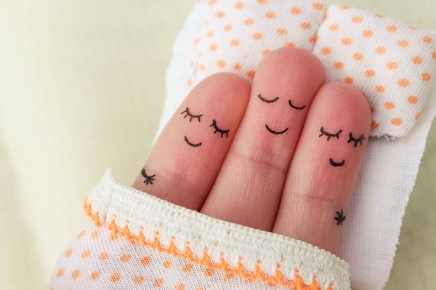 Art du doigt. un homme heureux dort avec deux femmes.