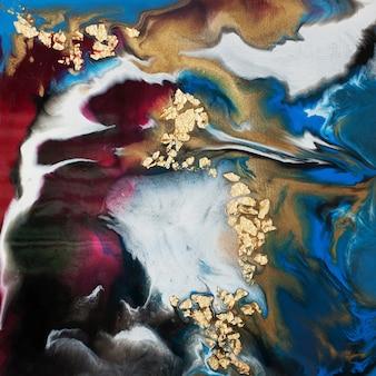 Art de la résine. peinture abstraite. coulée d'acrylique avec addition de feuille d'or et de poudre.