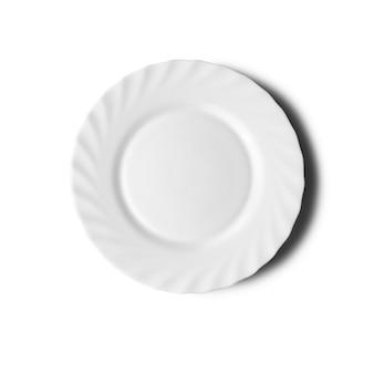 Assiette sur blanc avec une ombre. vue de dessus