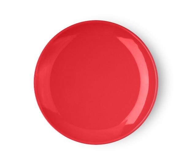 Assiette en céramique rouge isolé sur blanc