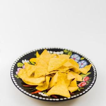 Assiette avec de délicieux nachos