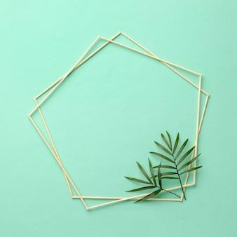 Assortiment de feuilles vertes avec cadre vide