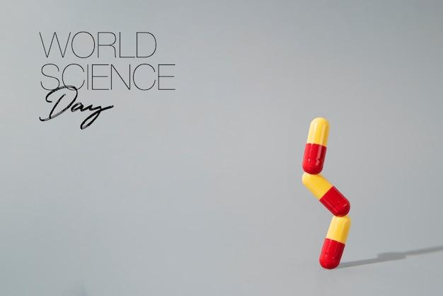 Assortiment de la journée mondiale de la science avec des pilules médicales