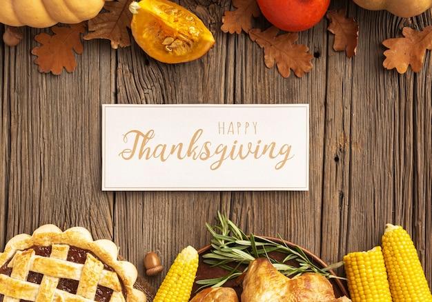 Assortiment vue de dessus avec citrouilles et signe de thanksgiving