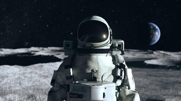 Un astronaute se tient à la surface de la lune parmi les cratères dans le contexte de la planète terre.