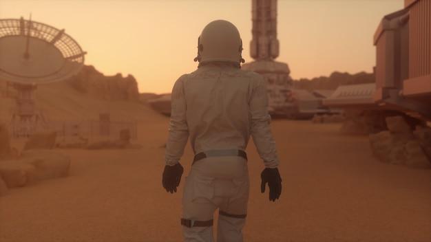 Astronaute seul sur mars marchant vers sa base
