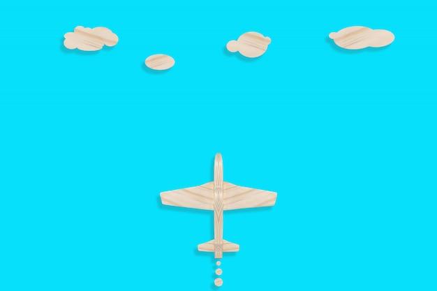 Avion en bois sur une surface bleue