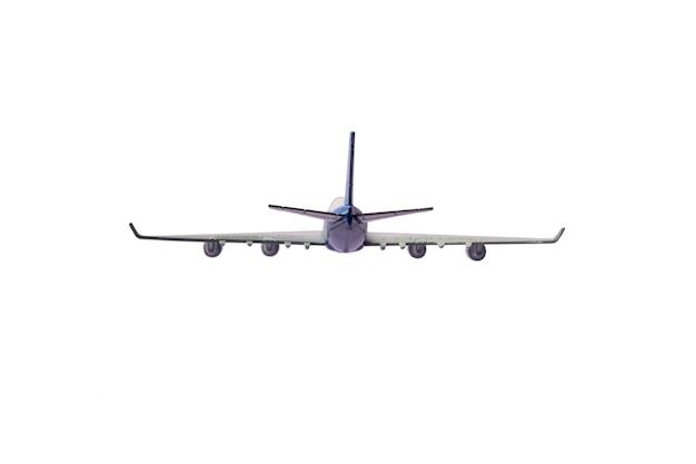Un avion de passagers vole dans les airs et voyage à destination isolé sur blanc