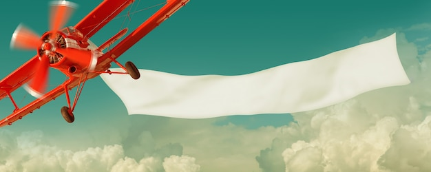 Avion rouge vintage volant dans le ciel avec une bannière vierge blanche