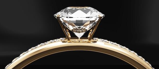 Bague de mariage en or avec diamants sur fond de studio noir