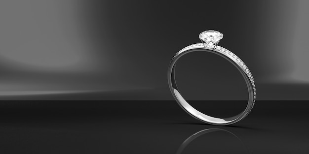 Bague de mariage en platine avec diamants sur fond noir studio